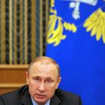 Vladimir Putin attends a meeting of Russian Accounts Chamber Board