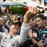 Mercedes driver Nico Rosberg of Germany pours champagne in the mouth of one of his mechanics after winning the Formula One Grand Prix of Monaco at the Monaco racetrack, in Monaco, Sunday, May 24, 2015. (ANSA/AP Photo/Gero Breloer)