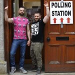 Partners Adrian, left and Shane, arrive to cast their vote at a polling station in Drogheda, Ireland, Friday, May 22, 2015.  Ireland began voting Friday in a referendum on Gay marriage which will require an amendment to the Irish constitution. Opinion polls throughout the two-month campaign suggest the government-backed amendment should be approved by the required majority of voters when results are announced Saturday.  (ANSA/AP Photo/Peter Morrison)