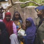 epa04728027 An undated handout picture released by the Nigerian army on 30 April 2015 made available 01 May 2015 and taken this week in an undisclosed location in the Sambisa Forest, Borno state, Nigeria shows a member of the Nigerian Army standing with a group of women and children rescued in an operation against the militant Islamist group Boko Haram. The Nigerian military reported Boko Haram hostages were held in terrible conditions in the Sambisa Forest  after they freed nearly 500 women and girls through the week.  EPA/NIGERIAN ARMY/HO BEST QUALITY AVAILABLE HANDOUT EDITORIAL USE ONLY/NO SALES