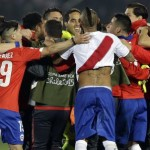 Chile's players celebrate after a Copa America semifinal soccer match against Peru at the National Stadium in Santiago, Chile, Monday, June 29, 2015. Chile kept alive its hopes of winning the Copa America for the first time with a 2-1 win over 10-man Peru.(ANSA/AP Photo/Ricardo Mazalan)
