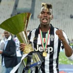 Juventus' Paul Pogba celebrate with the trophy of Italian Serie A soccer championship at the end of the match against SSC Napoli in Turin, Italy, 23 May 2015. ANSA/ALESSANDRO DI MARCO