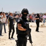epa04823722 Members of the Tunisian Security Services stand guard during a wreath laying ceremony at the site of a terror attack on tourists on a beach outside the Imperial Marhaba Hotel, al-Sousse, 140km east of Tunis, Tunisia, 29 June 2015. According to local reports 26 June, an assailant with handgrenades opened fire on tourists at two hotels, killing at least 38 people, including Germans, Brits and Belgians, and wounding several others, some while they were sunbathing, the attacker was killed later in a gun fight with Tunisian security services, who have since arrested other suspected associates, massively increased security and closed many Mosques believed to house radical preachers. The group which calls itself the Islamic State (IS) have claimed responsibility.  EPA/STR