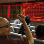 epa04838182 Chinese investors look at an electronic screen showing market movements at a securities brokerage house in Beijing, China, 09 July 2015. Chinese stocks jumped sharply 09 July after falling on opening for the third consecutive day, amid aggressive measures by the authorities to shore up share prices.  EPA/HOW HWEE YOUNG
