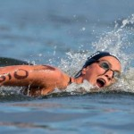epa04351584 Rachele Bruni from Italy competes in the women's 10km Open Water final during the 32nd LEN European Swimming Championships 2014 at the Gruenau course in Berlin, Germany, 13 August 2014.  EPA/TIM BRAKEMEIER