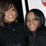 FILE - In this Feb. 12, 2011, file photo, singer Whitney Houston, left, and daughter Bobbi Kristina Brown arrive at an event in Beverly Hills, Calif.  The daughter of late singer and entertainer Whitney Houston was found Saturday, Jan. 31, 2015, unresponsive in a bathtub by her husband and a friend and taken to an Atlanta-area hospital. The incident remains under investigation.   (ANSA/AP Photo/Dan Steinberg, File)