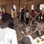 People gather inside the Redeemed Christian Church of God, after a bomb blast  in Potiskum, Nigeria, Sunday, July 5, 2015. A woman suicide bomber blew up in the midst of a crowded evangelical Christian church service in northeast Nigeria on Sunday and killed at least five people, witnesses said.(ANSA/AP Photo/Adamu Adamu Damaturu)