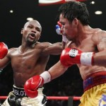 epa04731050  REPEATING TO ADD RESTRICTIONS AND CREDIT Floyd Mayweather Jr. (L) throws a left against Manny Pacquiao during their welterweight unification championship boxing fight at the MGM Grand Garden Arena in Las Vegas, Nevada, USA, on 02 May 2015.  EPA/ESTHER LIN