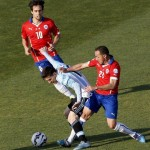 epa04831714 Argentinian Leo Messi and Chilean midfielder Marcelo Diaz fight for the ball  during the Copa America 2015 final soccer match between Chile and Argentina, at Estadio Nacional Julio Martinez Pradanos in Santiago de Chile, Chile, 04 July 2015.  EPA/Juan Carlos Cardenas