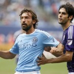 New York City FC's Andrea Pirlo, left, of Italy, battles for position against Orlando City SC's Kaka, of Brazil, during the second half of an MLS soccer game at Yankee Stadium, Sunday, July 26, 2015, in New York. New York defeated Orlando 5-3. (ANSA/AP Photo/Jason DeCrow)
