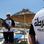 epa04826638 Tunisian policemen keep watch on the beach where tourists were shot dead in front of the Hotel Imperial Marhaba in Sousse, Tunisia, 01 July 2015. Tunisian authorities announced a plan to deploy 1000 armed policemen at tourist sites following the deadly attack on the beach that left 38 people killed on 26 June.  EPA/MOHAMED MESSARA