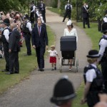 Britain's Prince William, Kate the Duchess of Cambridge, their son Prince George and daughter Princess Charlotte in a pram arrive for Charlotte's Christening at St. Mary Magdalene Church in Sandringham, England, Sunday, July 5, 2015.  (ANSA/AP Photo/Matt Dunham, Pool)
