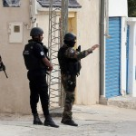 epa04459417 Members of the Tunisian security services take up a position around the area where police forces exchanged gunfire with alleged militants who had taken refuge in a house in the town of Oued Ellil, on the outskirts of the capital Tunis, Tunisia, 23 October 2014. According to Mohamed Ali Aroui, spokesman for the Interior Ministry, security forces surrounded a house containing a suspected terror cell believed to have been planning an attack during the upcoming parliamentary elections 26 October, and reports state as the opeation continued at least one Tunisian policeman was killed and several others wounded in an ensuing fire fight between Tunisian security forces and those inside the building.  EPA/MOHAMED MESSARA
