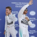 epaselect epa04830836 British Formula One driver Lewis Hamilton of Mercedes AMG GP (R) and German Formula One driver Nico Rosberg of Mercedes AMG GP (L) celebrate after the qualifying session at Silverstone race track, Northamptonshire, Great Britain, 04 July 2015. Lewis Hamilton took pole position while Nico Rosberg second. The 2015 Formula One Grand Prix of Great Britain will take place on Sunday 05 July.  EPA/VALDRIN XHEMAJ