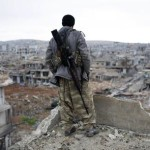 FILE - In this Jan. 30, 2015, file photo, a Syrian Kurdish sniper looks at the rubble in the Syrian city of Ain al-Arab, also known as Kobani. The Kurds of Syria and Iraq have become a major part of the war against the Islamic State group, with Kurdish populations in both countries threatened by the militants' advance. Syrian, Iraqi and Turkish Kurds took part in cross-border operations to help rescue tens of thousands of displaced people from the minority Yazidi group from Iraq's Sinjar Mountain in August last year and they continue to fight in cooperation with one another against the Islamic State group in areas along the Iraq-Syria border. (ANSA/AP Photo, File)