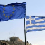 epa04834767 A Greek and a European Union flag flutter in front of the Acropolis hill in Athens, Greece, 07 July 2015. Eurozone member states on 07 July are waiting for the Greek proposals in order to discuss a new aid programme for Greece. Prime Minister Alexis Tsipras is heading to Brussels to participate in the summit. In the eurozone summit, that will also be attended by ECB president Mario Draghi and Eurogroup chief Jeroen Dijsselbloem, officials will discuss the actions to be taken after the referendum.  EPA/ORESTIS PANAGIOTOU