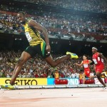 epa04903642 Jamaica's Usain Bolt brings home gold in the 4x100m men relay during the Beijing 2015 IAAF World Championships at the National Stadium, also known as Bird's Nest, in Beijing, China, 29 August 2015.  EPA/DIEGO AZUBEL