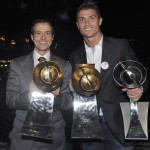 epa03044492 Real Madrid soccer player, Portuguese Cristiano Ronaldo (R), and his manager Jorge Mendes (L), pose with the trophies won during the Globe Soccer Awards ceremony held at Dubai, UAE, 28 December 2011.  EPA/JORGE MONTEIRO