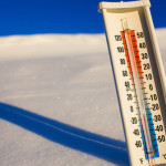Thermometer Stuck in Snow --- Image by © Jim Craigmyle/Corbis