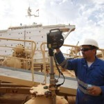epa03903854 A Libyan worker inspects a crude oil storage tank at the Mellitah Oil and Gas B.V. Oil Division Bouri field, about 130 kilometers north-west of Tripoli, Libya, 09 October 2013. The Mellitah Oil and Gas B.V. Oil Division Bouri field has remained open while others ports in Libya were closed due to labour disputes. The Bouri field is capable of an average daily production of 37,914 thousand barrels.  EPA/SABRI ELMHEDWI