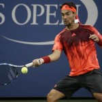 epa04907083 Fabio Fognini of Italy hits a return to Steve Johnson of the US during their match on the first day of the 2015 US Open Tennis Championship at the USTA National Tennis Center in Flushing Meadows, New York, USA, 31 August 2015. The US Open runs through 13 September, which is a return to a 14-day schedule.  EPA/JASON SZENES