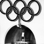 FILE - This July 27, 1984, file photo, shows 1960 Olympic Decathlon Gold Medalist Rafer Johnson lighting the Olympic torch during the Opening Ceremonies of the 23rd Olympiad in Los Angeles. If the city of Los Angeles becomes the U.S. candidate for the 2024 Olympics after Bostons recent drop from contention, the organizers proposed budget for the Summer Games would be $4.1 billion plus a $400 million contingency, a senior adviser to Mayor Eric Garcetti said Monday, Aug. 10, 2015. (ANSA/AP Photo, File)