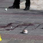 epa04975054 A pair of blood-stained women's canvas shoes besides a pool of blood with police and medical objects outside the main Jerusalem police station located in Arab East Jerusalem near French Hill after a Palestinian woman was shot after she attacked Israeli police with a knife, 12 October 2015. According to police the woman injured one policeman lightly when he stopped her for an identity check and then he managed to shoot her, injuring her moderately. A shot while elater another Palestinian stabbing occurred in the East Jerusalem neighborhood of Pizgat Ze'ev, injuring a 13-year-old Israeli boy, who is in critical condition.  EPA/JIM HOLLANDER