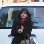 Dorotea De Pippo, l'ex colf di Giorgio, Mariangela Allione e la madre di lei Emilia, uccisi a Caselle Torinese, durante il sopralluogo delle forze dell'ordine nella villetta il 6 gennaio 2014. ANSA/ ALESSANDRO DI MARCO