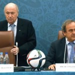 epa04864735 (FILE) A file picture dated 25 July 2015 of FIFA President Joseph Blatter (L) taking a seat next to UEFA President Michel Platini (R) during a seminar ahead of the Preliminary Draw for the FIFA World Cup 2018 in St.Petersburg, Russia. Michel Platini on 29 July 2015 confirmed his intention to run for the FIFA presidency as successor to Joseph Blatter. Platini said in a statement on the UEFA website he has written to the 209 members of FIFA declaring his candidacy and asking for support in his bid to lead the global football governing body.  EPA/MARCUS BRANDT