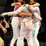 epa03822506 Members of the team of Italy, clockwise, Valerio Aspromonte, Andrea Cassara, Giorgio Avila and Andrea Baldin celebrate after winning the gold against the United States in the final of mens foil team competition at the World Fencing Championship in Budapest, Hungary,  12 August 2013.  EPA/IMRE FOLDI HUNGARY OUT
