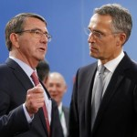 epa04968398 US Secretary of State for Defense Ashton Carter (L) and NATO Secretary General Jens Stoltenberg talk during a NATO Defense Ministers Council at alliance headquarters in Brussels, Belgium, 08 October 2015. NATO chief Jens Stoltenberg said the defence ministers would approve the creation of two more command posts in Hungary and Slovakia.  EPA/OLIVIER HOSLET