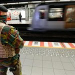 epa05040865 A Belgian soldier observes the platform of a Brussels' metro station following the terror alert level being raised to 4/4, in Brussels, Belgium, 25 November 2015. Regular life began to return to Brussels on 25 November as schools reopened and underground train services partially resumed, despite the city remaining under maximum terrorism alert in the wake of the November 13 attacks on Paris. The Belgian capital has been under security alert level four since 21 November, due to what Belgian Prime Minister Charles Michel described as a 'serious and imminent threat.'  EPA/LAURENT DUBRULE
