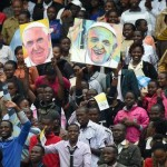 People react as Pope Francis arrives for a meeting with the youth at the Kasarani stadium in Nairobi, Kenya, 27  November 2015. Pope Francis is on a six days visit that will take him to Kenya, Uganda and the Repulic of Central Africa from 25 to 30 November. ANSA/DANIEL DAL ZENNARO
