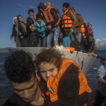 Migrants and refugees disembark from a vessel after their arrival from the Turkish coast to the northeastern Greek island of Lesbos, on Thursday, Nov. 26, 2015. About 5,000 migrants are reaching Europe each day along the so-called Balkan migrant route, stoking tensions among the countries on the Balkan migrant corridor including Greece, Macedonia, Serbia, Croatia and Slovenia. (ANSA/AP Photo/Santi Palacios)