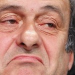 FILE - In this May 28, 2015 file photo President of UEFA Michel Platini grimaces during a press conference following a meeting of the UEFA board ahead of the FIFA congress in a hotel in Zurich, Switzerland.  (ANSA/AP Photo/Michael Probst, File)