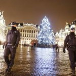 Belgian police officers patrol the Grand Place in downtown Brussels, Belgium, Monday, Nov. 23, 2015. The Belgian capital Brussels has entered its third day of lockdown, with schools and underground transport shut and more than 1,000 security personnel deployed across the country. (ANSA/AP Photo/Michael Probst)