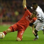 epa05043600 Liverpool's James Milner (L) in action with  Bordeaux's Andre Biyogo Poko (R) during the UEFA Europa League group B soccer match between Liverpool FC and FC Girondins de Bordeaux held at Anfield in Liverpool, Britain, 26 November 2015.  EPA/PETER POWELL