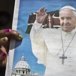 A churchgoer holds a copy of the Catholic Mirror newspaper showing a photograph of Pope Francis, after mass outside the Holy Family Minor Basilica in downtown Nairobi, Kenya Sunday, Nov. 22, 2015. Pope Francis follows his predecessors next week Nov. 25-30, 2015 to visit Africa whose growing numbers of Catholics are seen as a bulwark for a church seeking to broaden its appeal amid secularism, competing Christian faiths and violent extremism, in a trip that will take him to Kenya, Uganda and the Central African Republic. (ANSA/AP Photo/Ben Curtis)