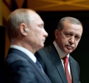 A handout picture provided by Turkish Presidential Press Office shows Russian President Vladimir Putin (L) and his Turkish counterpart Recep Tayyip Erdogan (R) attend a press conference in the new presidential palace in Ankara, Turkey, 01 December 2014.   EDITORIAL USE ONLY, NO SALES        ANSA /TURKISH PRESIDENTIAL PRESS OFFICE / HANDOUT