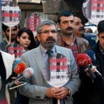 epa05045561 Slain Tahir Elci (C), the head of the local chamber of lawyers, speaks to media just before he was killed during a demonstration in Diyarbakir, Turkey 28 November 2015. Two people were killed and several others wounded when members of the banned Kurdistan Workers' Party (PKK) clashed with security forces in the south-eastern Turkish city of Diyarbakir, President Recep Tayyip Erdogan confirmed on 28 November. One of those shot dead was the head of the local chamber of lawyers, Tahir Elci, who had been talking to the media with a group of lawyers in the Sur quarter of the city when he was hit, local media reported. The other fatality was a police officer.  EPA/STR