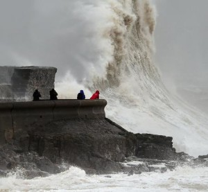 Waves crash over the sea wall at Porthcawl in Wales, Monday Feb. 8, 2016, as winds of nearly 100mph battered Britain after Storm Imogen slammed into the south coast bringing fierce gusts and torrential downpours. (Joe Giddens/PA via AP) UNITED KINGDOM OUT NO SALES NO ARCHIVE
