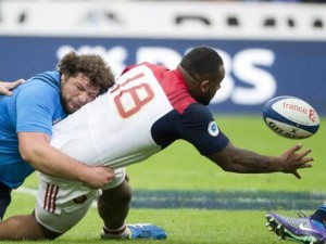 France's Jefferson Poirot, center,  is tackled by Italy's  Matteo  Zanusso , during the Six Nations tournament rugby match between France and Italy, at Stade de France in Saint-Denis, north of Paris, Saturday  Feb. 6, 2016. (ANSA/AP Photo/Jacques Brinon)