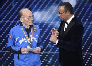 Italian host Carlo Conti and Italian masters athlete Giuseppe Ottaviani (L), 99 yeas old, on stage during the Sanremo Italian Song Festival at the Ariston theater in Sanremo, Italy, 09 February 2016. The 66th Festival della Canzone Italiana runs from 09 to 13 February. ANSA/CLAUDIO ONORATI
