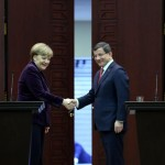 epa05149762 German Chancellor Angela Merkel (L) shakes hands with Turkish Prime Minister Ahmet Davutoglu (R) during a press conference in Ankara, Turkey, 08 February 2016. Merkel and Davutoglu called for the creation of safe migration routes to Europe and for NATO to play a bigger role in the fight against human traffickers.  EPA/STRINGER