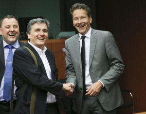 Greek Finance Minister Eucleidis Tsakalotos (C) and the President of Eurogroup, Dutch Finance Jeroen Dijsselbloem (R), greet each other prior to an Eurogroup Finance ministers meeting in Brussels, Belgium, 09 May 2016. Eurozone's ministers will discuss a deal to unblock a 5 billion Euro aid package to Greece. Man on left is not identified.  ANSA/OLIVIER HOSLET