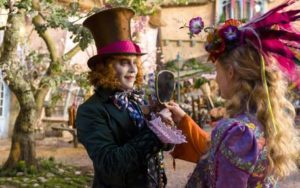 "This image released by Disney shows Johnny Depp as the Mad Hatter, left, and Mia Wasikowska as Alice in a scene from ""Alice Through the Looking Glass,"" premiering in US theaters on May 27. (Peter Mountain/Disney via AP)"
