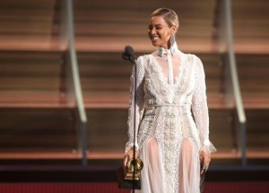Beyonce presents the award for record of the year at the 58th annual Grammy Awards on Monday, Feb. 15, 2016, in Los Angeles. (Photo by Matt Sayles/Invision/ANSA/AP)
