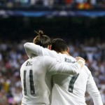 epaselect epa05289893 Real Madrid's Welsh winger Gareth Bale (L) celebrates with his Portuguese teammate Cristiano Ronaldo (R) after scoring the 1-0 lead during the UEFA Champions League semi final, second leg soccer match between Real Madrid and Manchester City at Santiago Bernabeu stadium in Madrid, Spain, 04 May 2016.  EPA/JUAN CARLOS HIDALGO