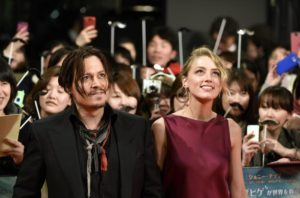 epa04588641 US actor/cast member Johnny Depp (L) and partner US actress Amber Heard (R) arrive for the premiere of 'Mortdecai' in Tokyo, Japan, 27 January 2015. The movie will be released in Japanese theaters on 06 February.  EPA/FRANCK ROBICHON