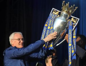Leicester's manager Claudio Ranieri, left, shows the Premier League Trophy to fans at Victoria Park during the victory parade to celebrate winning the English Premier league title in Leicester, England, Monday, May 16, 2016. (ANSA/AP Photo/Rui Vieira) [CopyrightNotice: Copyright 2016 The Associated Press. All rights reserved. This material may not be published, broadcast, rewritten or redistribu]